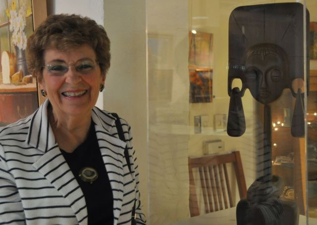 """Nathalie standing by """"Bejewelled"""" made of a single piece of Wenge wood."""
